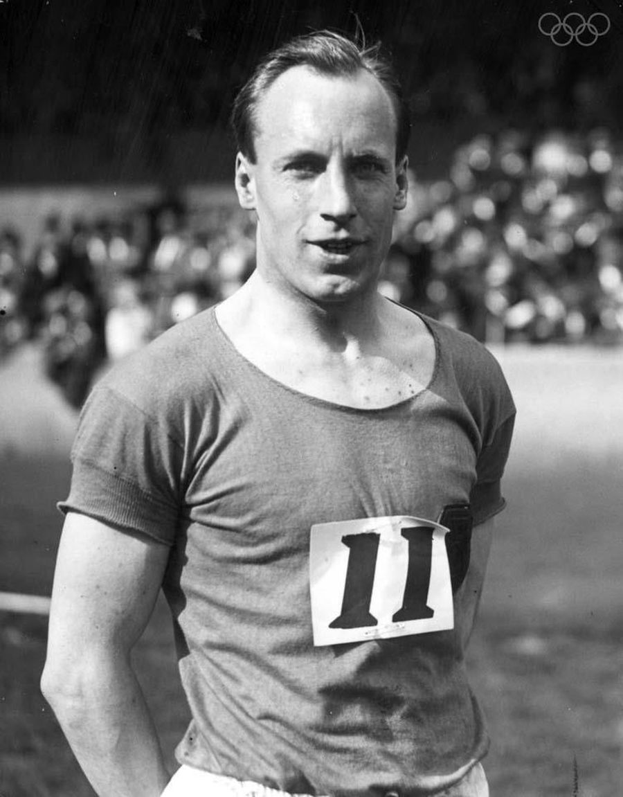 "Nicknamed as ""The flying Scotsman"", in this picture the gold medalist Eric Liddell dons an athletic T-shirt during the Paris games in 1924."