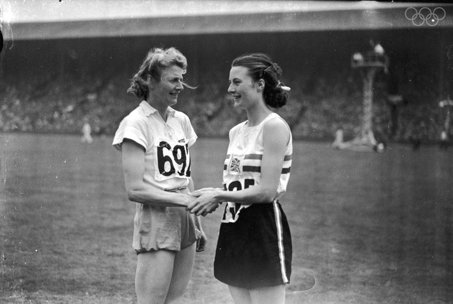 Silver medallist Maureen Gardner of the UK congratulates gold medalist, Fanny Blankers-Koen of the Netherlands during the 1948 London games.