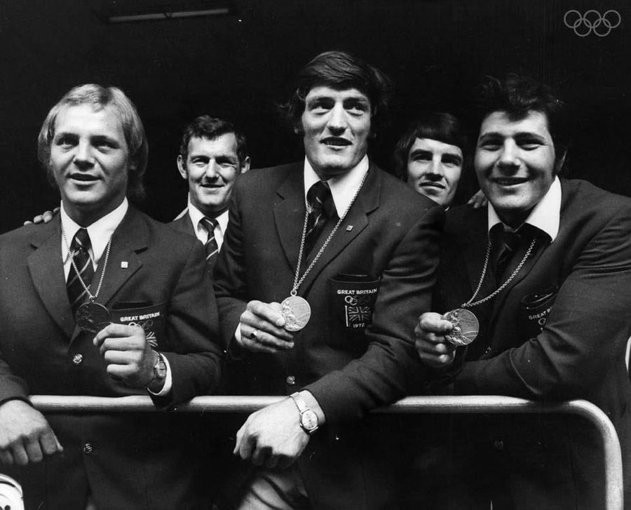 Donning the national ceremonial uniform, Britain's judo team celebrates their earned medals at the 1972 Munich Olympics. Left to right: Brian Jacks, Dave Starbrook and Angelo Parisi.