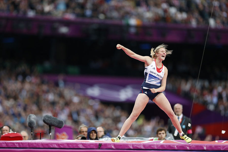 Holly Bleasdale shows her prowess in the pole vault while donning the controversial kit designed by Stella McCartney.