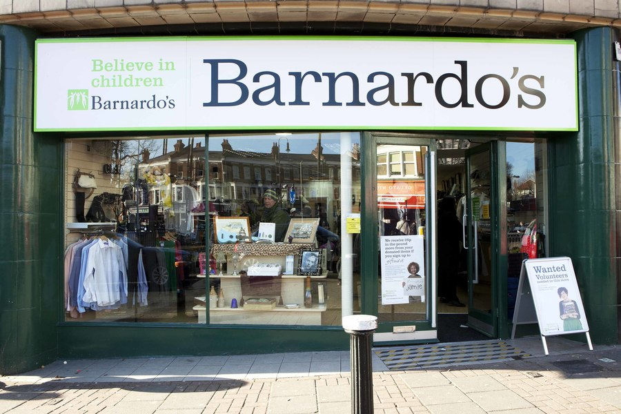 Michelle Collins visits and volunteers at Barnardo's retail store.