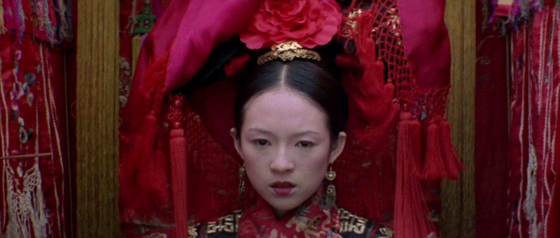 "Zhang Ziyi as Jen Yu in the martial arts classic ""Crouching Tiger Hidden Dragon"" wears the traditional red attire for a Chinese bride. Source"